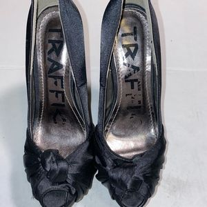 Traffic black satin heels with knot on top, size 9